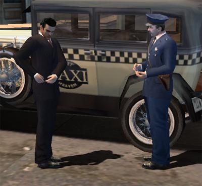 Policjant dający Tommy'emu mandat